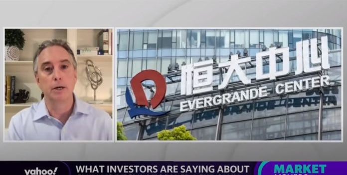 China's regulatory crackdown sends overseas stocks spiraling, plus a look at the Evergrande fallout