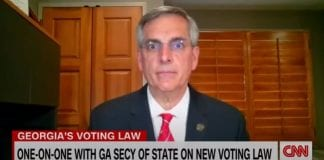 Tapper asks official, who Trump assailed, why he supports Georgia's voting bill